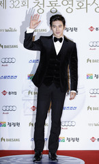 South Korean actor Kosoo poses for photographs before the Blue Dragon Film Awards in Seoul