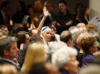 A bidder waves at the auctioneer during Christie's Green Auction in New York