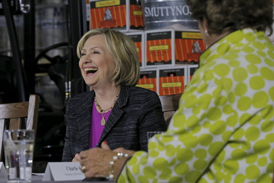 Democratic presidential candidate Hillary Clinton smiles while participating in a discussion with the local small business community at the Smuttynose Brewery in Hampton
