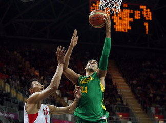 Brazil's Sousa gets past China's Yi for a lay-up during their men's preliminary round Group B basketball match at the Basketball Arena during the London 2012 Olympic Games
