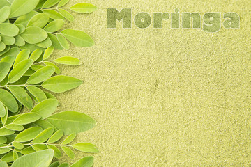 Moringa leaves on wooden background (Moringa oleifera)