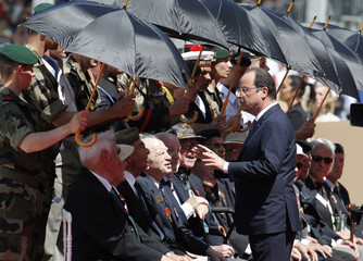 French President Hollande talks with war veterans during the International Ceremony at Sword Beach, Ouistreham