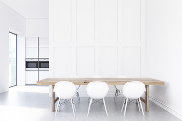 White kitchen with wooden table, oven