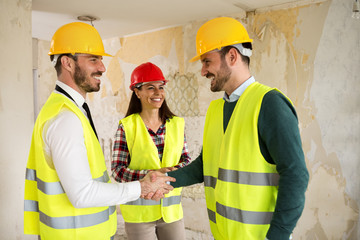 Engineers shaking hands at the construction site