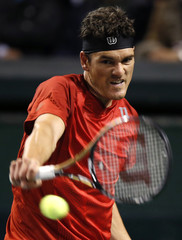 Canada's Dancevic returns a shot against Japan's Soeda during their Davis Cup world group first round tennis match in Tokyo