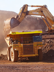 Trackhoe fills a dump truck in the South Limb pit at Atlas Iron's Pardoo mine