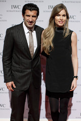 Former Portuguese soccer player Luis Figo and his wife arrive for the Swiss watchmaker IWC party in Geneva