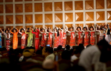 Performers perform during a farewell ceremony for parliament members at the Parliament in Naypyitaw