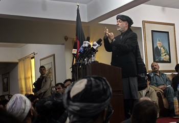Afghan President Hamid Karzai speaks to locals during a shura  in Kandahar city