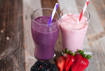 Milkshakes made with fresh blueberries and strawberries in a glass
