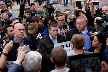 U.S. Republican presidential candidate Ted Cruz speaks with supporters of fellow candidate Donald Trump during a campaign event at The Mill in Marion, Indiana