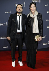Musician Ibrahim Maalouf and an unidentified guest pose as they arrive at the 40th Cesar Awards ceremony in Paris