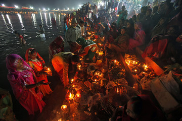 Hindu devotees prepare to offer prayers to the Sun god Surya during the Hindu religious festival of Chatt Puja in Chandigarh