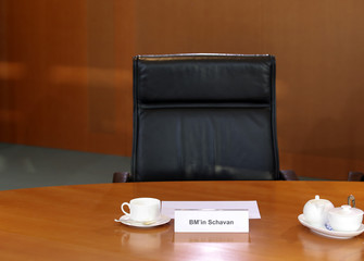 The empty seat of German Education Minister Schavan is pictured before the cabinet meeting at the Chancellery in Berlin