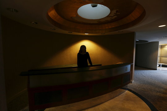 Roberta Dunn, a former TWA receptionist from 1970-2001, is seen in silhouette inside the Ambassadors Club at the Trans World Airlines Flight Center at John F. Kennedy Airport in the Queens borough of New York