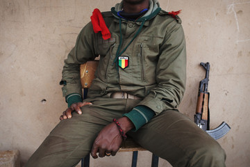 A Mali flag patch is pictured on the uniform of a Malian soldier in Konna, Mali