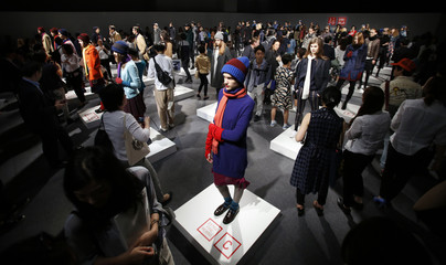 Models display Uniqlo's Fall/Winter collection during its unveiling event in Tokyo