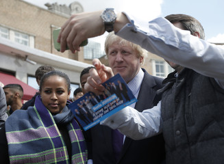 London Mayor Boris Johnson poses for selfies during campaigning for the local parliamentary seat in Uxbridge, west London, Britain