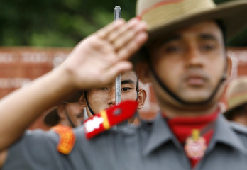Indian paramilitary soldiers take part in the full-dress rehearsal for the country's Independence Day celebrations in Agartala