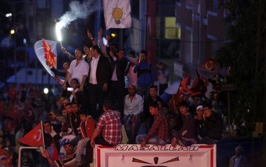 Supporters of Turkey's Prime Minister Tayyip Erdogan wave flags and shout slogans in Ankara