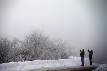 People take pictures of a landscape with their cell phones in the Serbian mountain of Rtanj southeast Belgrade