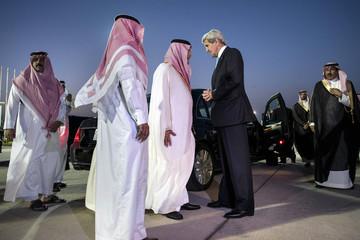 Saudi FM Prince Saud al-Faisal bids farewell to U.S. Secretary of State Kerry at King Abdulaziz International Airport in Jeddah