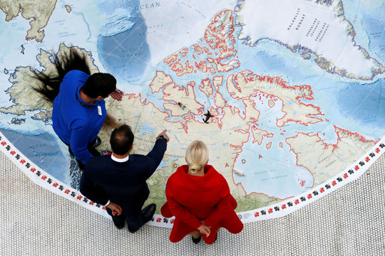 Norway's Crown Prince Haakon and Crown Princess Mette-Marit look at Canada on an Arctic map at the Canadian Museum of Nature in Ottawa