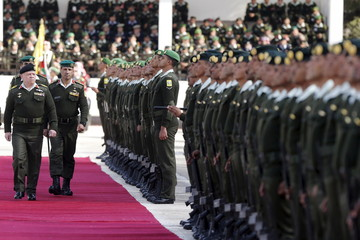 Jordan's King Abdullah reviews the honour guard during a ceremony in Amman