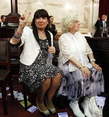 Giselle, sister of Argentina's President Fernandez de Kirchner, gestures to their mother Ofelia while waiting for the opening session of the 131st legislative term of Congress in Buenos Aires