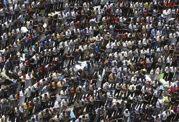 Protesters gather for Friday prayers before protesting in Cairo's Tahrir Square