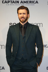 """Cast member Evans poses at the French premiere of the film """"Captain America: The Winter Soldier"""" in Paris"""