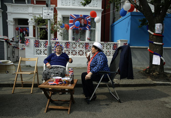 Local residents eat ice creams during a street party to celebrate the Royal wedding