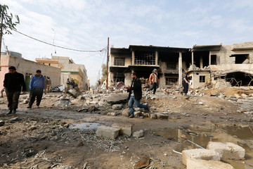 Damaged buildings are seen during a battle with Islamic State militants in Rashidiya