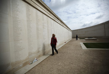 Sara Jones the widow of Lieutenant-Colonel 'H' Jones looks for his name engraved on the Armed Forces memorial at the National Memorial Arboretum in Alrewas
