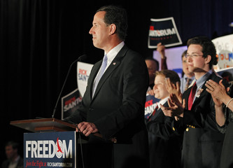 U.S. Republican presidential candidate Santorum, flanked by his sons Patrick and Daniel, addresses supporters at his Wisconsin and Maryland primary night rally in Mars, Pennsylvania