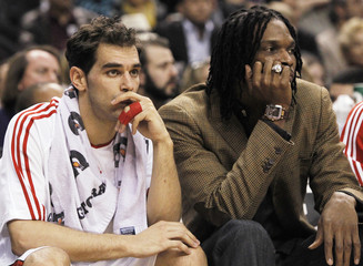 Raptors Bosh and Calderon sit on the bench as their team plays the Knicks during their NBA basketball game in Toronto