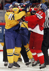 Sweden's Kronwall fights with Czech Republic's Prucha during their 2012 IIHF ice hockey World Championship game in Stockholm