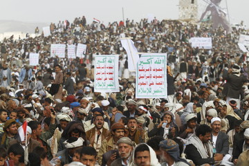 Houthi followers attend a rally marking one year of Saudi-led air strikes in Yemen's capital Sanaa