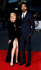 """Nicole Kidman poses alongside Dev Patel as they arrive for the gala screening of the film """"Lion"""", during the 60th British Film Institute (BFI) London Film Festival at Leicester Square in London"""