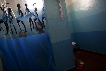 Young girls take a bath after taking ballet lessons at the New Dreams dance studio in the Luz neighborhood known to locals as Cracolandia (Crackland) in Sao Paulo
