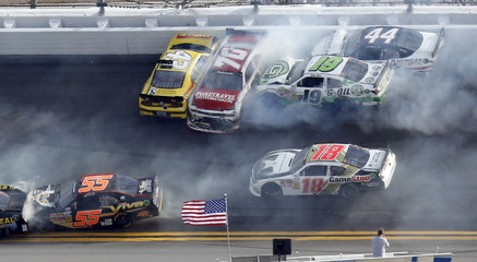 NASCAR drivers crash in an eleven car pile-up late in the NASCAR Nationwide Series DRIVE4COPD 300 race at the Daytona International Speedway in Daytona Beach