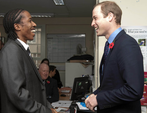 Britain's Prince William speaks to Junior Smart, the SOS Business Relationship Manager, during a visit to the head office of the St Giles Trust, in Camberwell, south east London