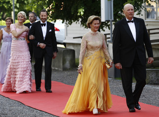 Norway's King Harald and Queen  Sonja followed by Prince Haakon and wife Crown Princess Mette-Marit arrive for a Government dinner at the Eric Ericson Hall in Skeppsholmen
