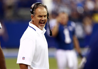 Indianapolis Colts head coach Chuck Pagano yells to his players during the first half of their NFL football game against the Oakland Raiders in Indianapolis