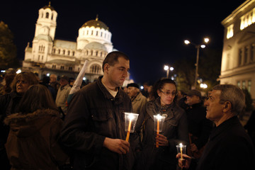 Scientists from BAS hold candles as they rally in front of Alexander Nevski cathedral during a silent protest in Sofia