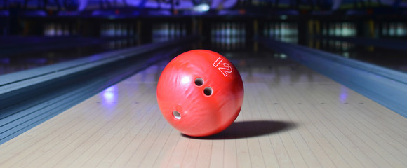 Red bowling ball on the track. Active leisure. Sport game.