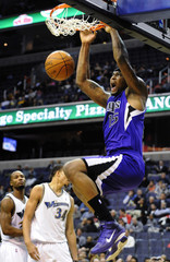 Sacramento Kings' Cousins dunks against the Washington Wizards during the first half of their NBA basketball game in Washington
