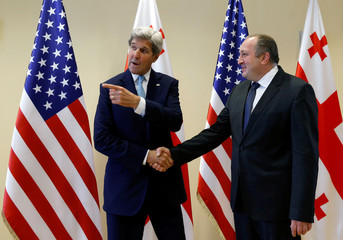 U.S. Secretary of State John Kerry shakes hands with Georgia's President Georgy Margvelashvili during a meeting in Tbilisi