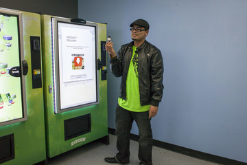 A man shows one gram of the Girl Scout Cookies strain of marijuana that he purchased for $15 using a ZaZZZ vending machine at Seattle Caregivers in Seattle
