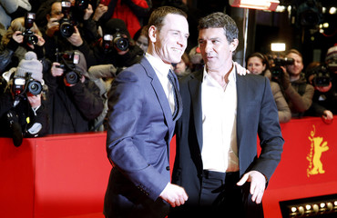 """Cast members Banderas and Fassbender arrive for the screening of their movie """"Haywire"""" at the 62nd Berlinale International Film Festival in Berlin"""